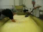 Lydia and Stu stirring the curd during scald