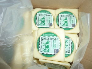 A box of hand waxed wedges of award winning Wenleydale cheese for the Yorkshire Hamper Company