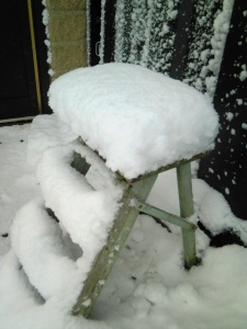 The stool outside shows how much snow has fallen since Sunday