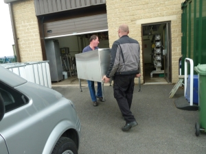 Paul from Brytec and Stu carrying Victor into the dairy